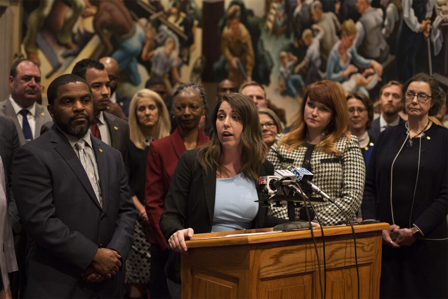 Rep. Crystal Quade and House Democrats speak to news reporters following the first day of the Missouri legislative session on Wednesday in Jefferson City.