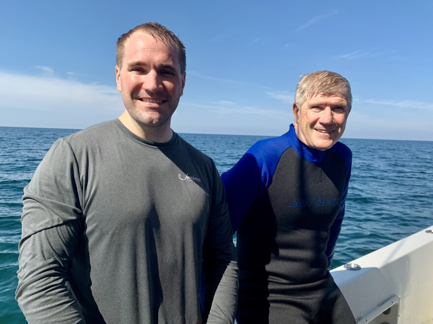 Texas residents Justin Herris (L), an Air Force pilot, and his dad Bob, a veteran, enjoyed a scuba diving trip together at the Circle of Heroes underwater military memorial.