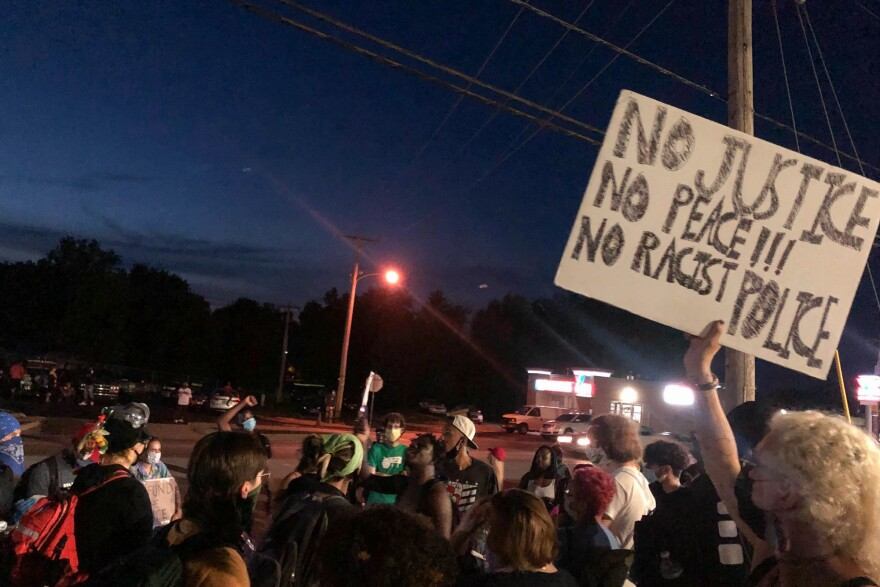 Protesters gathered outside the Florissant Police Department headquarters on Sunday to demand that authorities charge two officers who were with former officer Joshua Smith when he drove his unmarked police vehicle into a man. June 21, 2020