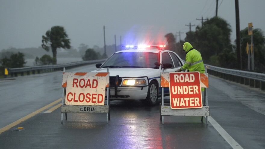 Police block the road entering Cedar Key, Fla., as Hurricane Hermine neared the Florida coast.