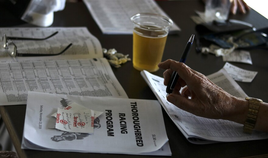 racing programs and beer on a table