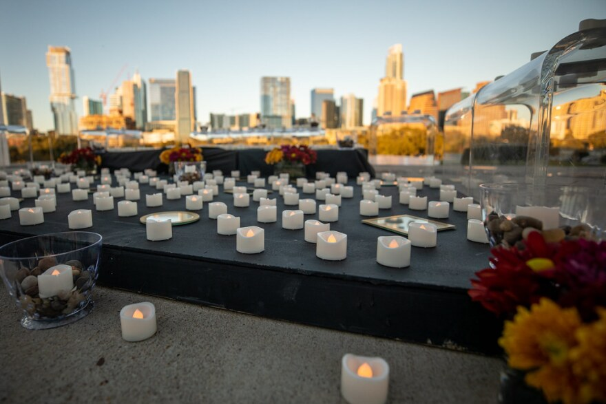 A candle tribute to Travis County residents who have died from COVID-19 complications is set up outside the Long Center.