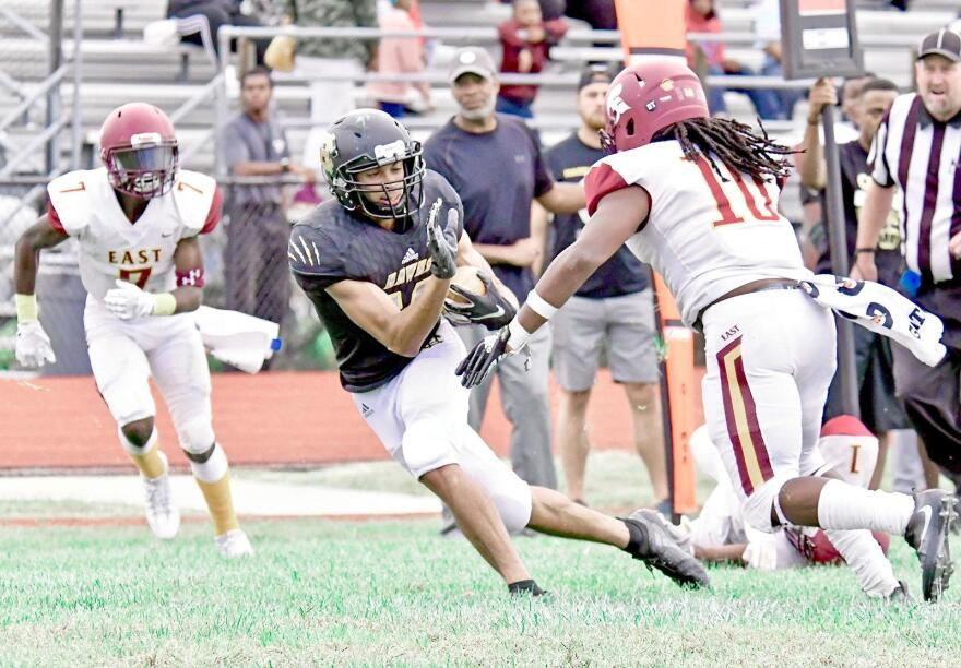 Hazelwood Central wide reciever Kayden Jackson (16) tries to move past Hazelwood East defender Tavon Henley (10) during their Sat., Sept. 21, 2018 game at Central. The Hawks of Hazelwood Central went on to defeat the Spartans 27-20.