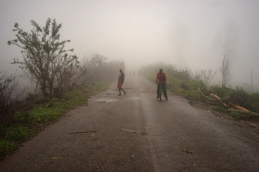 Villagers emerge from a mist in a settlement in Zimbabwe, one of the countries struck by Cyclone Idai.