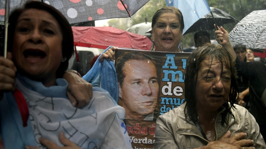 "Under heavy rain, people take part in a ""Marcha del silencio"" (March of Silence) Wednesday in Buenos Aires, Argentina, one month after the death of prosecutor Alberto Nisman."