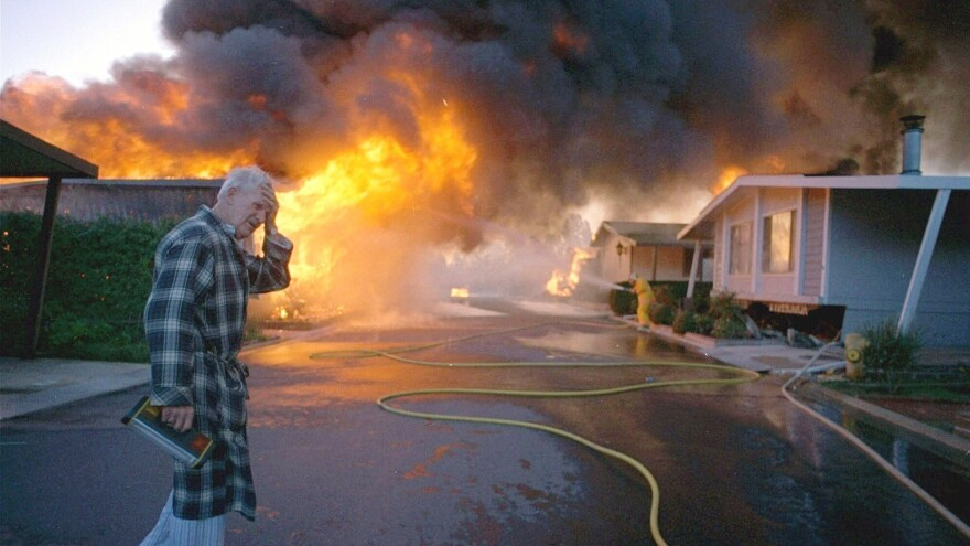 Ray Hudson reacts as a friend's home goes up in flames in Sylmar, Calif., after a major earthquake hit the San Fernando Valley area of Los Angeles in January 1994. The Northridge earthquake killed dozens of people and smashed thousands of buildings.