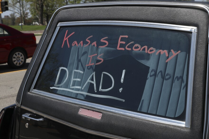 Last week, protesters pressured Kansas Gov. Laura Kelly to speed the lifting of stay-at-home orders. (Photo by Nomin Ujiyediin, Kansas News Service)