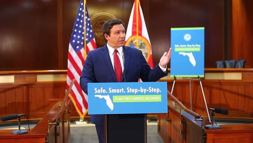 DeSantis announced his three phase plan behind a podium.