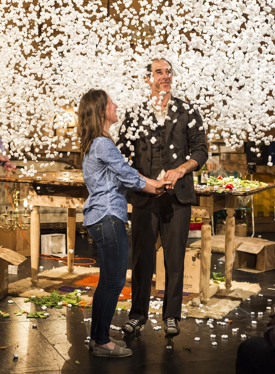 "After a dinner date, complete with ice skate tap dancing, Geoff Sobelle and his audience member ""date"" gets showered with packing peanuts."