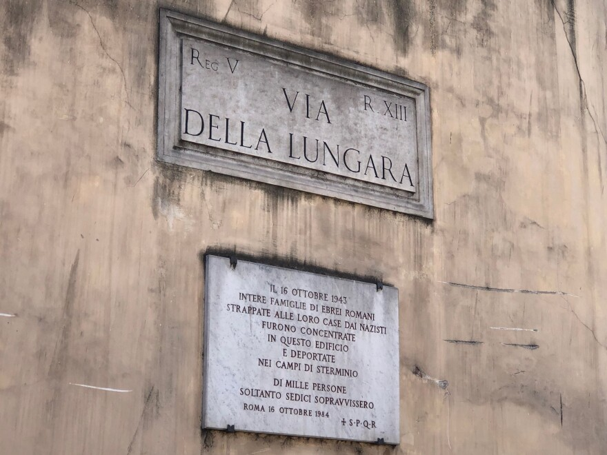 "A plaque in Rome commemorates the roundup and deportation to death camps of Jewish families by the Nazis on Oct. 16, 1943. ""Of more than 1000 persons, only 16 survived,"" the plaque says."