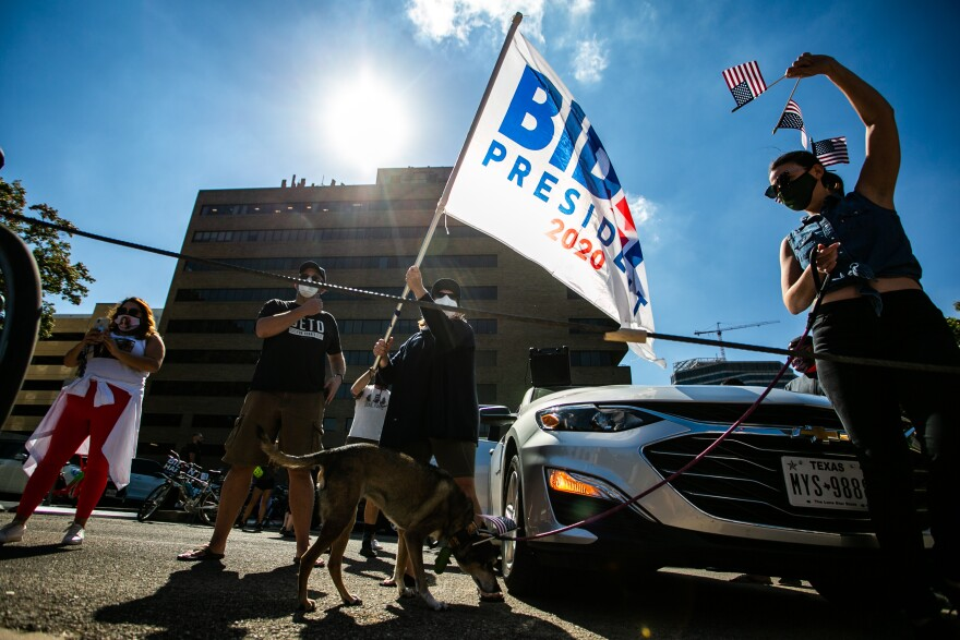 Biden supports hold a Biden flag during demonstrations downtown Austin following the announcement of the 2020 presidential elections.