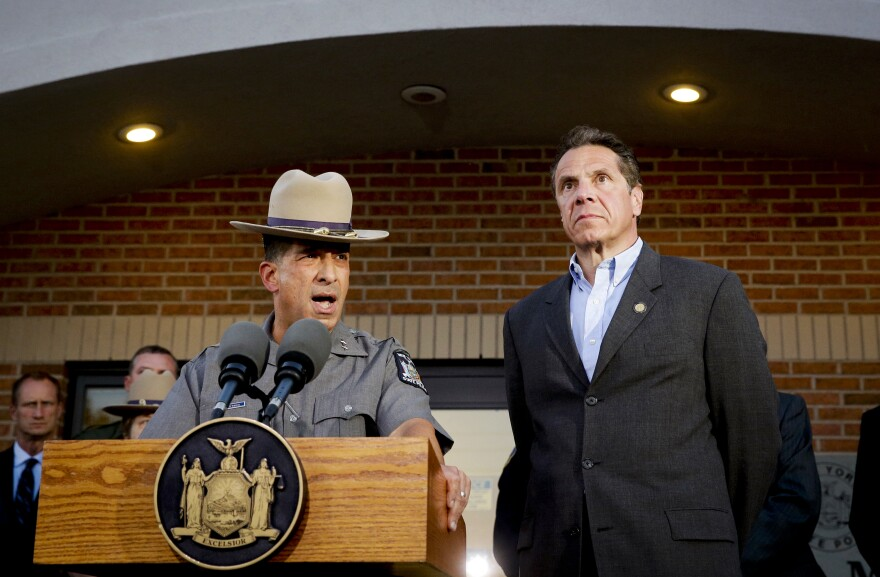 New York State Police Superintendent Joseph D'Amico, left, and Gov. Andrew Cuomo speak to members of the media during a news conference on June 26 in Malone, N.Y. On Tuesday, 12 officials from the Clinton Correctional Facility in Dannemora, N.Y., were placed on leave following a prison break and manhunt for convicted murderers David Sweat and Richard Matt.