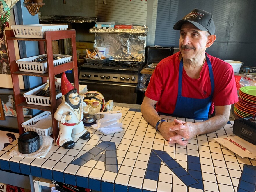 Nick's Cafe owner Nick Andurlakis says his business near the Denver Federal Center has dropped about 20 percent since the partial government shutdown began. He thinks the decrease is due to a combination of the shutdown and the holidays.