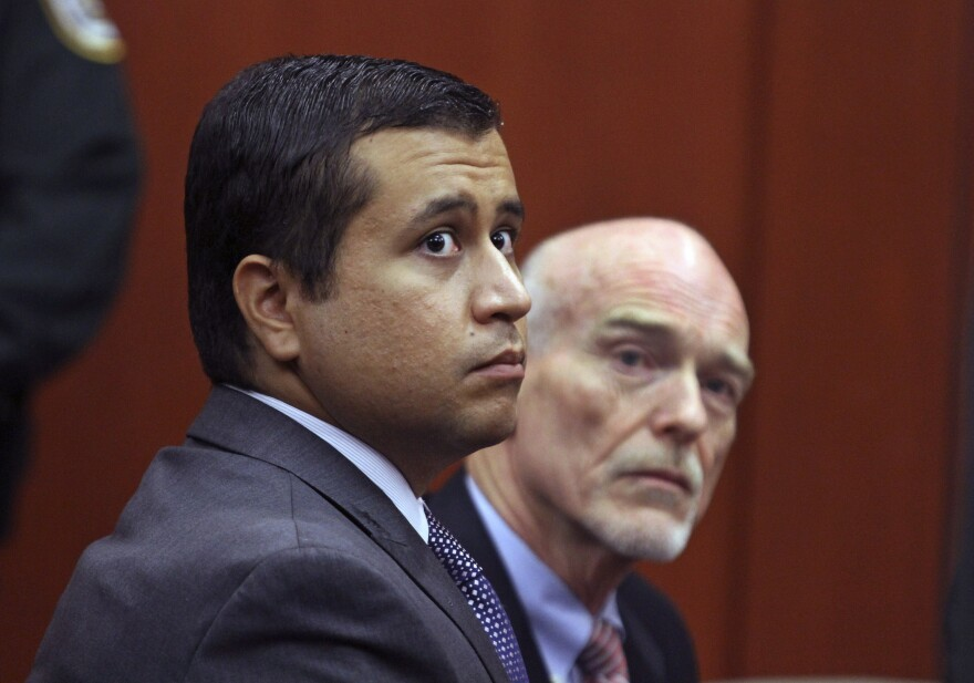 """George Zimmerman (left) and his attorney appear in court for a bond hearing in June. Zimmerman's case sparked a nationwide debate about so-called """"stand your ground"""" laws."""