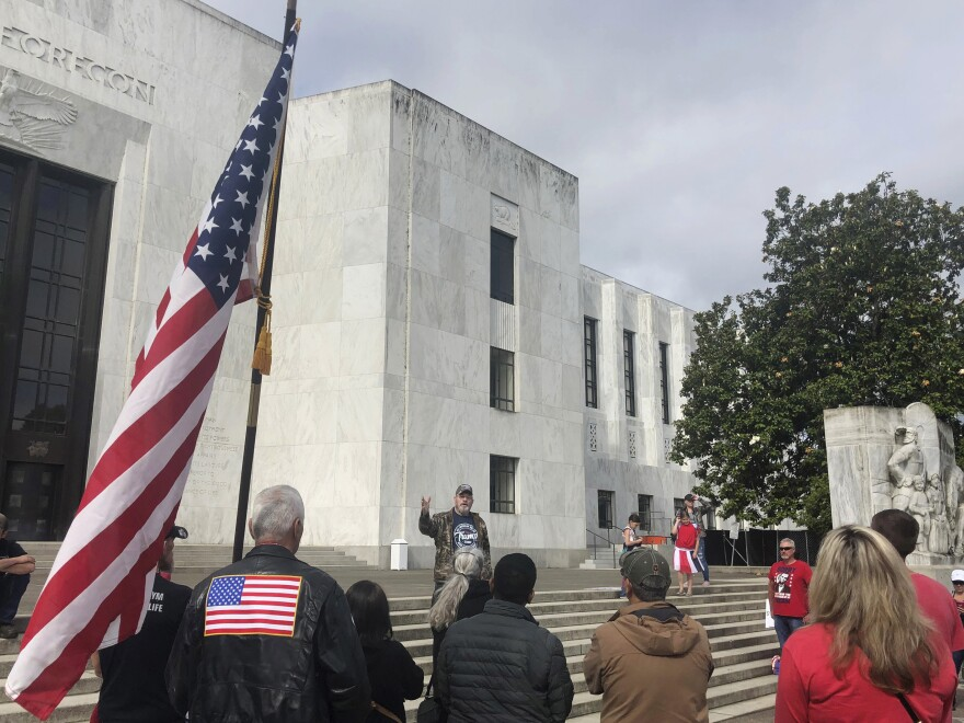On Sunday, a small crowd showed its support of a Republican walkout outside the Oregon state Capitol in Salem.