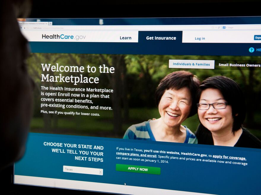A woman looks at the HealthCare.gov insurance exchange site on Tuesday in Washington, D.C.