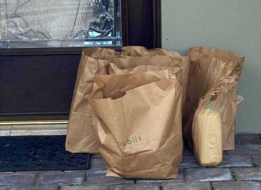 Grocery bags by a front door