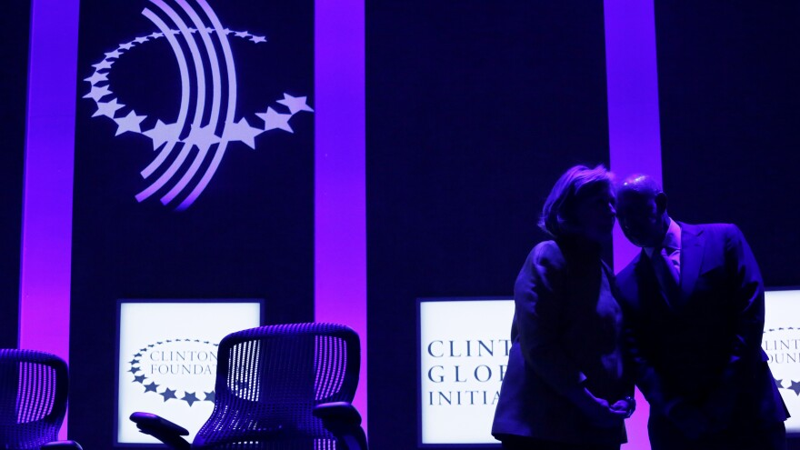 Hillary Clinton chats with Goldman Sachs Chairman and CEO Lloyd Blankfein onstage during a panel discussion in 2014 of the Clinton Foundation's Clinton Global Initiative.