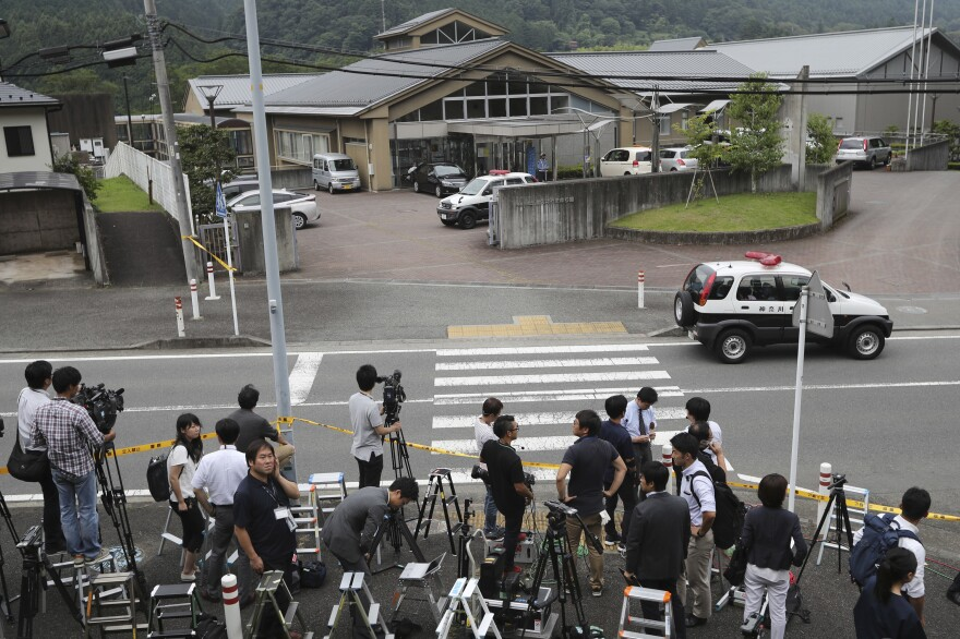 Journalists gather in front of Tsukui Yamayuri-en, an assisted care facility where at least 19 people were killed and dozens injured in a knife attack in Sagamihara, outside Tokyo Tuesday.
