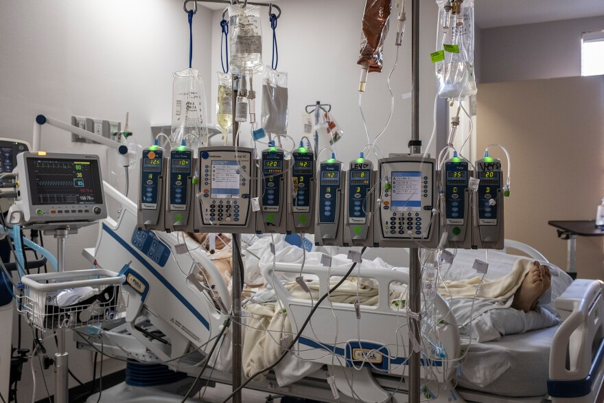 IV pumps and electrocardiogram machines are seen in a patient's room in the COVID-19 intensive care unit at the United Memorial Medical Center on Dec. 7 in Houston.