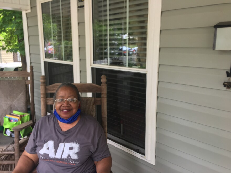 Mattie Marshall sits on her porch one block away from where the Charlotte protests first erupted about one month ago.