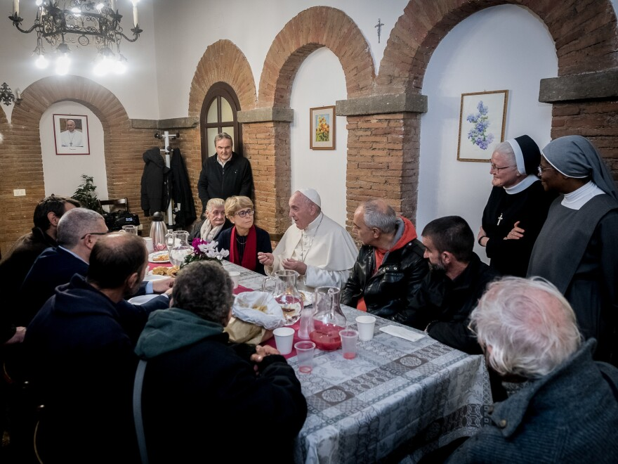 "Pope Francis shares a meal with guests and volunteers of the ""Palace of the Poor."""