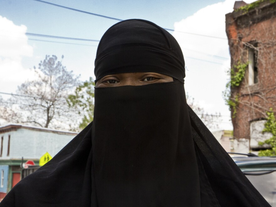 Aishia Muhammed, who lives in West Philadelphia, says she is outraged that men are dressing as Muslim women to commit crimes.