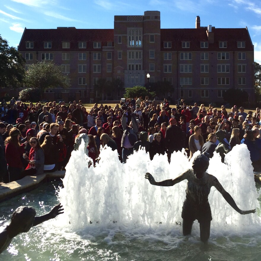 Students gathered on FSU's Landis Green after a shooting at the school's library.