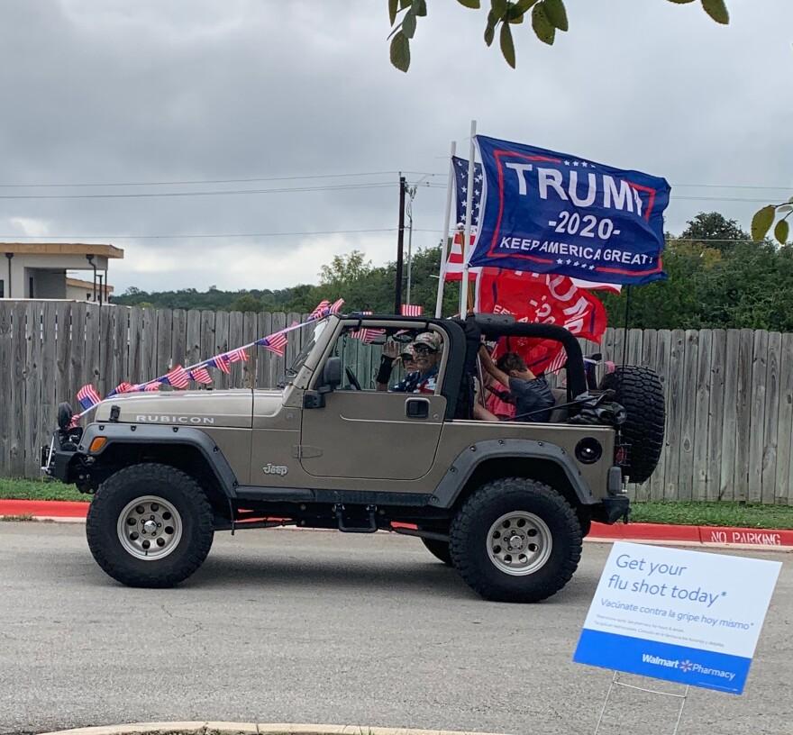 A jeep full of people participate in a Trump Train event in Boerne.