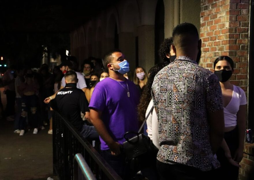 students in line outside gainesville bar