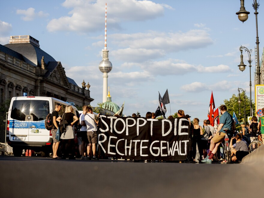"""Demonstrators hold a banner with the message """"Stop the Right-Wing Violence"""" during a June 18 march in Berlin against the killing of politician Walter Lübcke."""