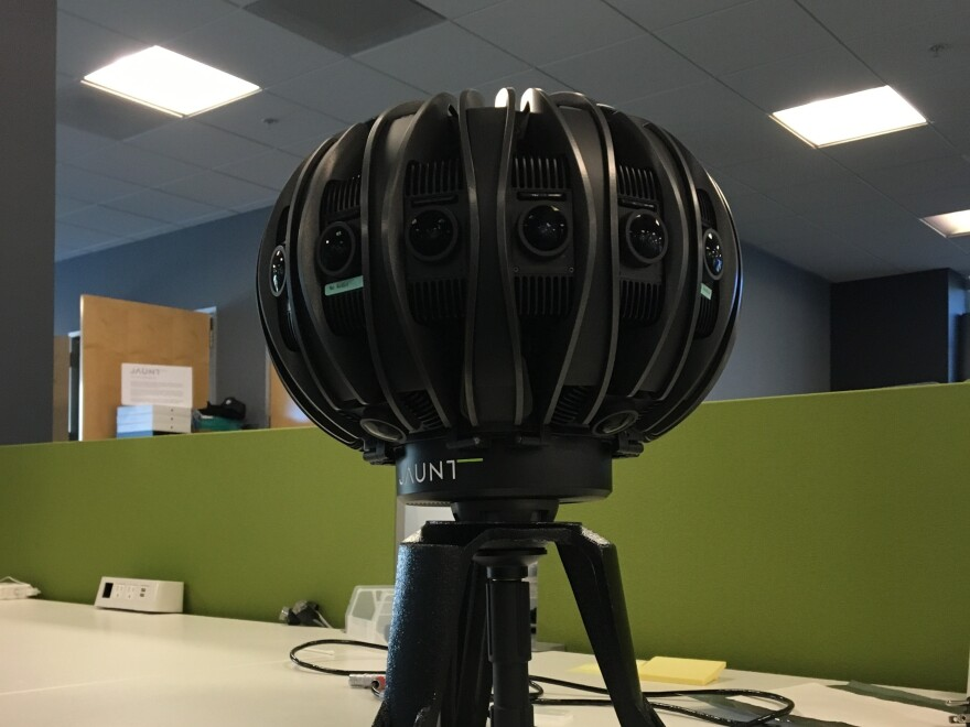A camera developed by Jaunt VR features more than 12 lenses arrayed around a basketball-sized device. The device may be used to develop content for headsets built by three companies, all coming out in 2016.