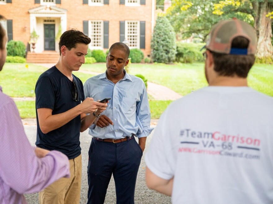 Coward stands alongside campaign volunteers in Richmond, Va.'s Windsor Farms neighborhood.
