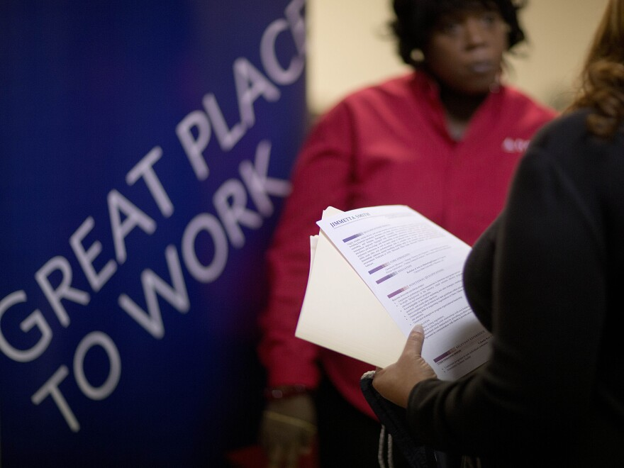Part of the scene at a job fair for veterans and family members earlier this month in Marietta, Ga.