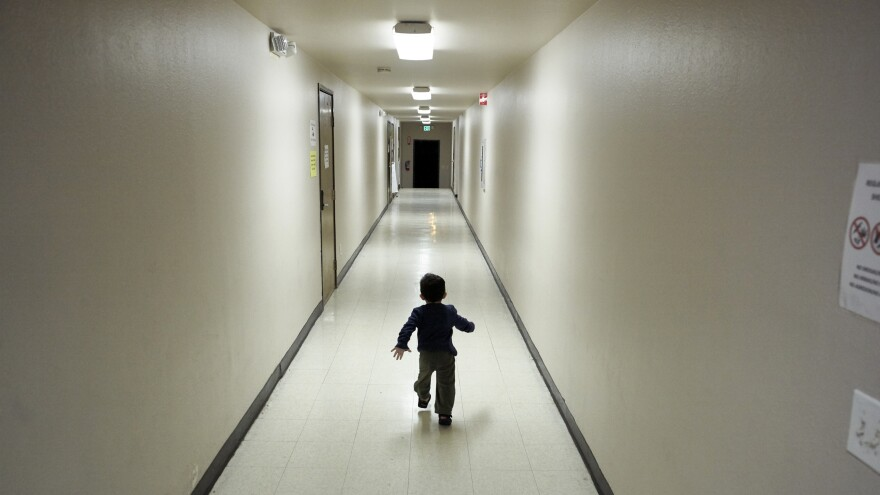 An asylum-seeking boy from Central America runs down a hallway in December after arriving at a shelter in San Diego. Immigrant advocates say they are suing the U.S. government for allegedly detaining immigrant children too long and improperly refusing to release them to relatives.