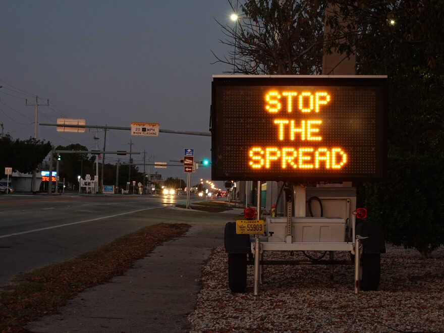 A sign warning motorists about the coronavirus in Key West, Fla. The U.S. Senate passed a $2 trillion relief measure Wednesday night intended to help hospitals, workers and businesses hit hard by the rapidly spreading virus.