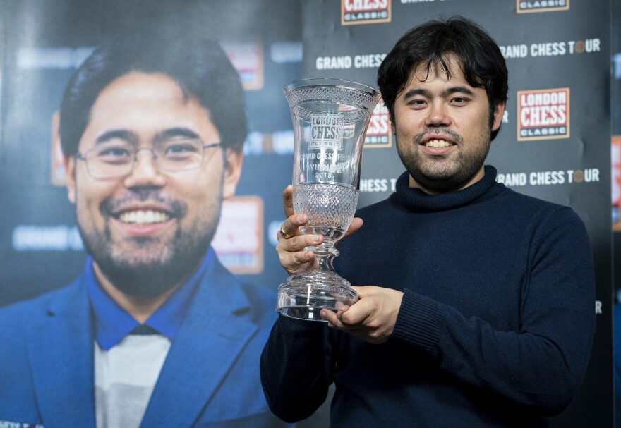 Hikaru Nakamura celebrating his victory with the trophy in the 2018 Grand Chess Tour.