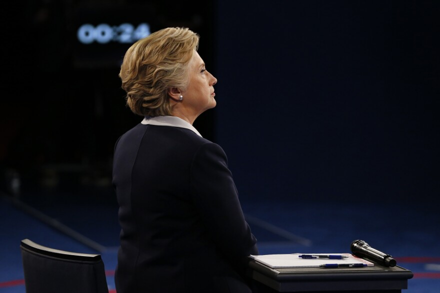 Hillary Clinton looks on during the second presidential debate. In 1975 Clinton was the court appointed lawyer for a man accused of raping Kathy Shelton, who was in the audience that night.