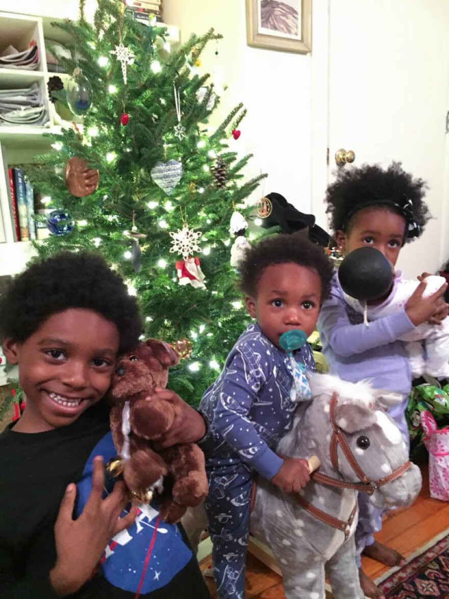 Yennie Neal-Achigbu's kids, Zuri (from left), Xoan and Lyon, celebrate the first of many Christmases with Jamie Olivieri in 2014, months after the death of Neal-Achigbu's husband.