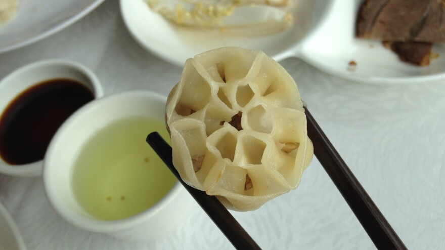 <strong>The Lotus Dumpling</strong>: Stuffed with pork and lotus root, this dumpling has 13 holes on the top, just like the lotus seedpod.