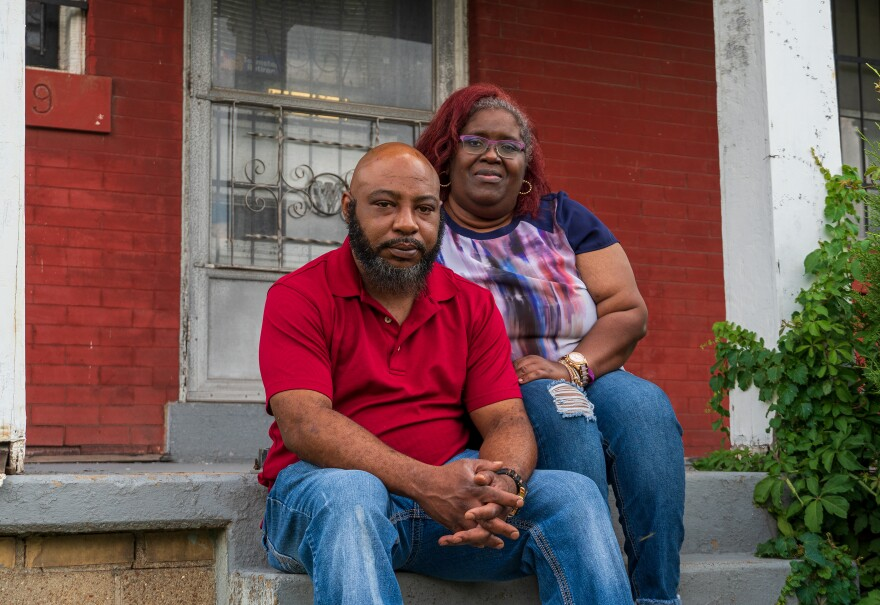 Damon Giboney and Patricia Dees sit on the front steps of their home on Delmar Boulevard on July 29, 2020.