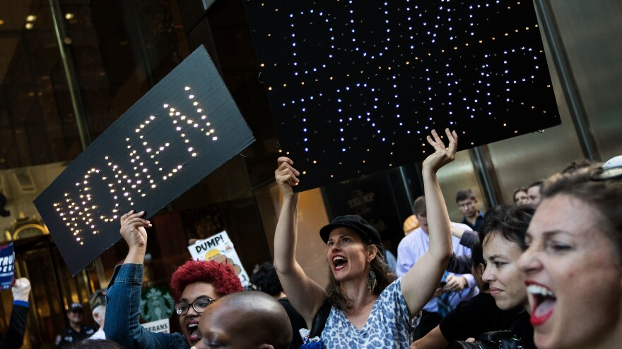 A group of protesters, made up mostly of women, rally against then-Republican presidential candidate Donald Trump outside of Trump Tower in New York City on Nov. 3, 2016.