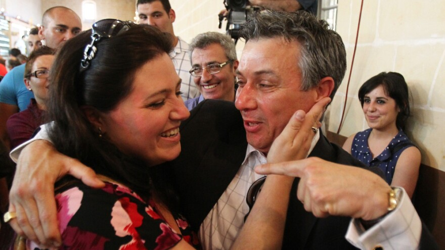 """Nationalist MP Jeffrey Pullicino Orlando, right, celebrates the victory of the """"yes"""" camp with yes movement chairman Deborah Schembri in the non-binding referendum to legalise divorce in Malta at a polling station in Valetta in May."""