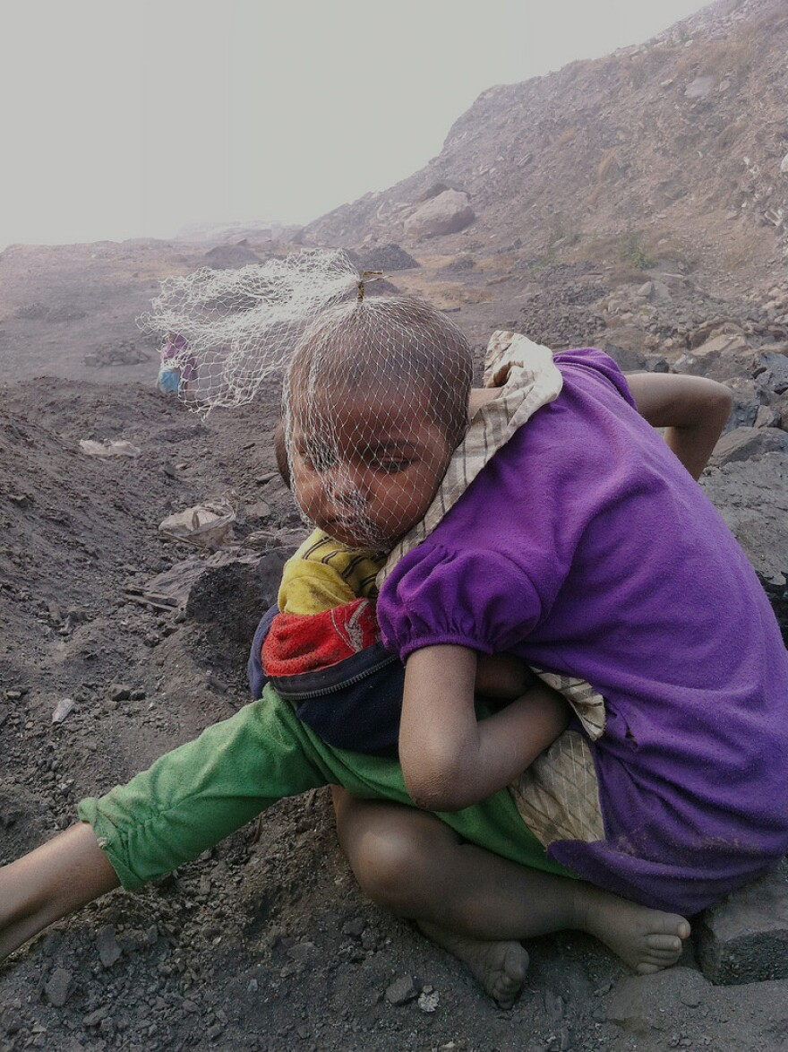 Children wait for their parents — coal pickers at a mine in Jharia — to return from work.