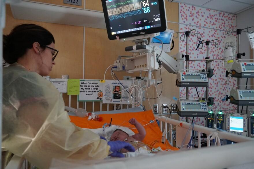 A nurse at St. Louis Children's Hospital attending to an infant that was born premature.