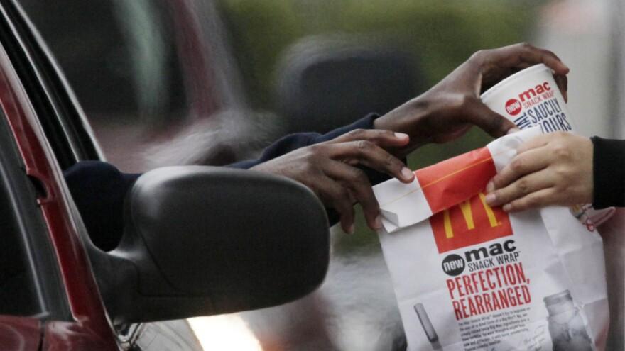 Customer gets fries at McDonalds.
