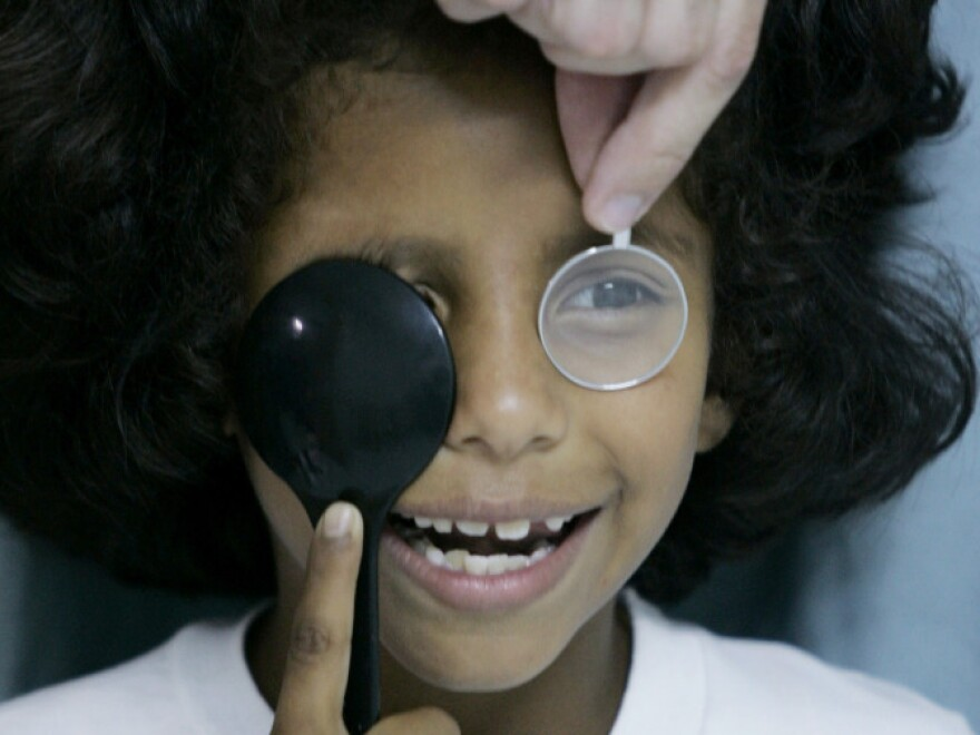 A child receives an eye exam in the city of Popayan, some 230 miles southwest of Bogota, Colombia. In Some developing countries, less than 5 percent of those needing corrective vision assistance receive it.