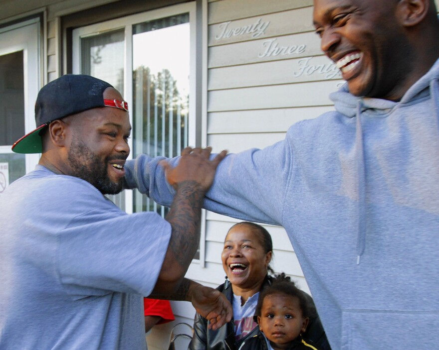 The new guidelines are part of the Obama administration's effort to address long mandatory minimum sentences. Antwain Black (left) was released early after sentencing laws were first eased in 2010.