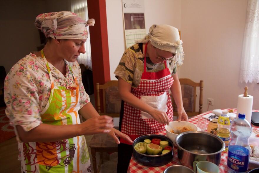 Missouri Botanical Garden researcher Ashley Glenn learning to cook in Bosnia from a homemaker named Dunja.