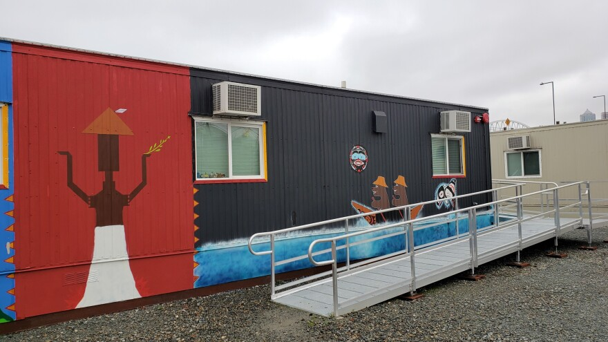 Residents are painting the exterior of each trailer in Eagle Village with Native imagery.